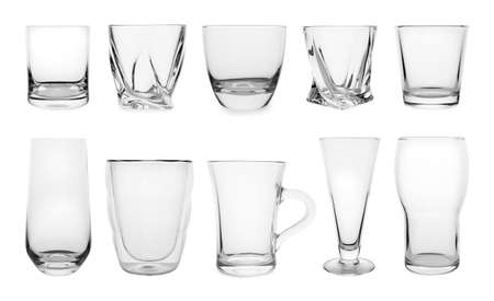 Set of different empty glasses on white background Фото со стока