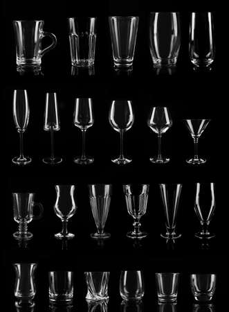 Set of different empty glasses on black background Stock Photo