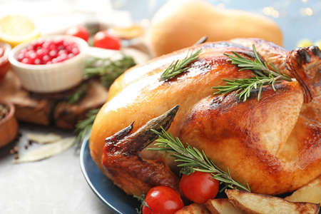 Delicious roasted turkey on table, closeup. Space for text