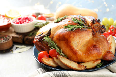 Delicious roasted turkey for traditional festive dinner on table