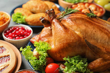 Delicious roasted turkey for traditional festive dinner on table, closeup