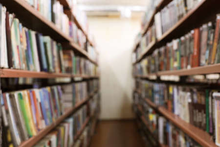 Blurred view of shelving units with books in library