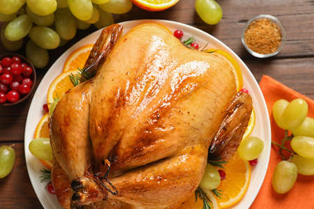 Platter of cooked turkey with garnish on table, top view Stock Photo