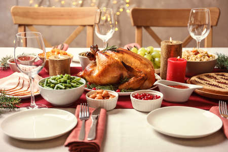 Traditional festive dinner with delicious roasted turkey served on table