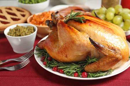 Delicious roasted turkey served on festive table