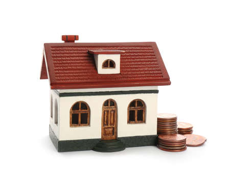 House model and coins on white background. Money saving concept 免版税图像