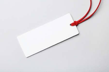 Cardboard tag with space for text on light background, top view 스톡 콘텐츠
