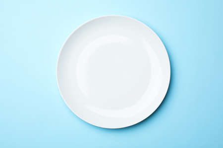Stylish ceramic plate on color background, top view Stock Photo