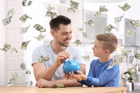 Family with piggy banks and money at home