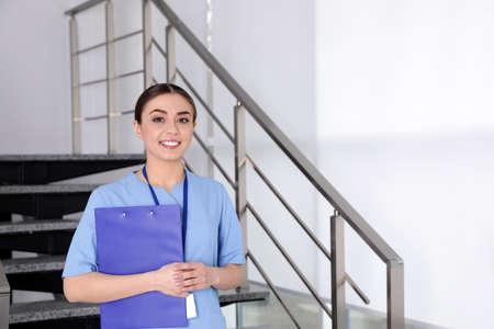 Portrait of young nurse in hospital. Medical assistant Stock Photo - 124988395