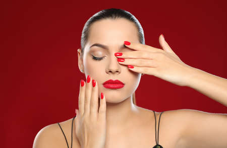 Portrait of beautiful young woman with bright manicure on color background. Nail polish trends