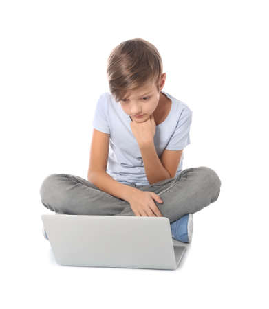 Child with laptop on white background. Danger of internet Imagens