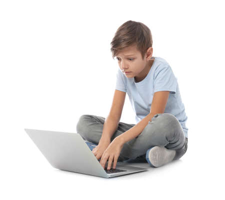Shocked child with laptop on white background. Danger of internet