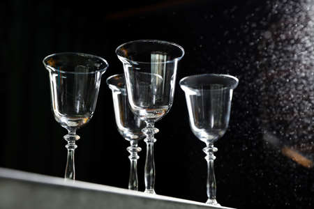 Empty clean glass on dark background, low angle view Banco de Imagens