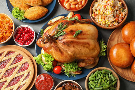 Traditional festive dinner with delicious roasted turkey served on table, flat lay Stock Photo