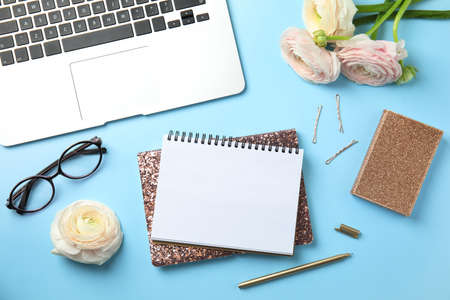 Flat lay composition with glittering notebooks and laptop on color background. Space for text