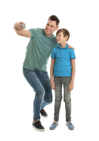 Dad and his son taking selfie on white background Banco de Imagens