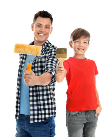 Dad and his son with painting tools on white background