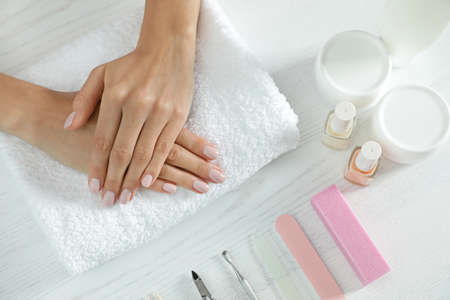 Woman waiting for manicure and tools at table, top view. Spa treatment