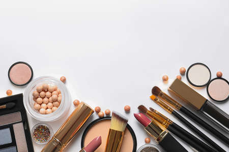 Different luxury makeup products on white background, top view Фото со стока