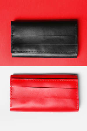 Stylish wallets on color background, top view