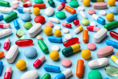 Different pills on color background, closeup view 스톡 콘텐츠