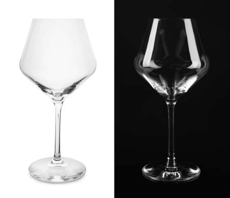 Empty glasses on white and black background