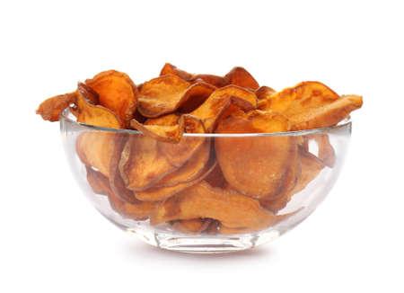 Bowl of tasty sweet potato chips isolated on white Reklamní fotografie - 124655379