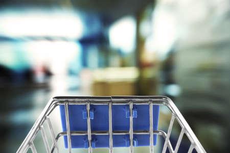 Metal shopping basket on blurred background, closeup Reklamní fotografie