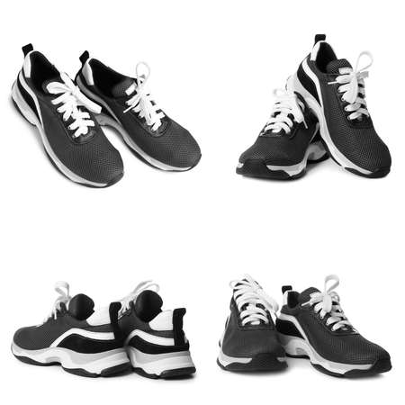 Set of modern training shoes on white background