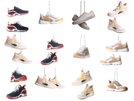 Set of different stylish shoes hanging on white background 版權商用圖片
