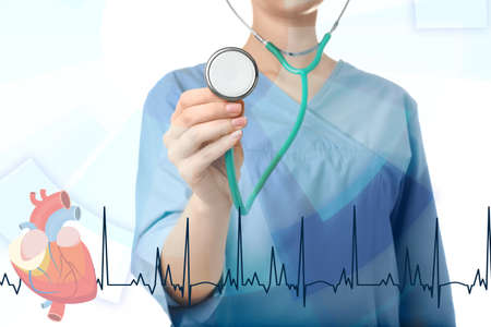 Doctor with stethoscope and cardiogram on light background, closeup. Medical service