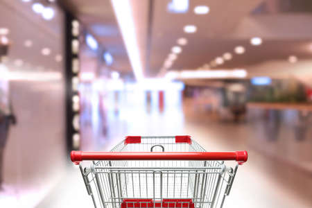 Blurred view of mall and empty shopping basket