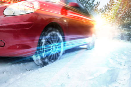 Modern car on snowy country road, closeup. Design with light effects 스톡 콘텐츠 - 124655789