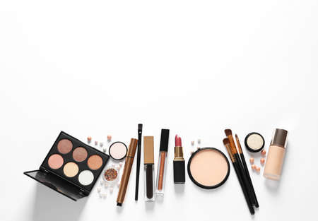 Different luxury makeup products on white background, top view 版權商用圖片