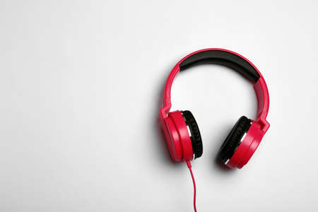 Stylish modern headphones on white background, top view