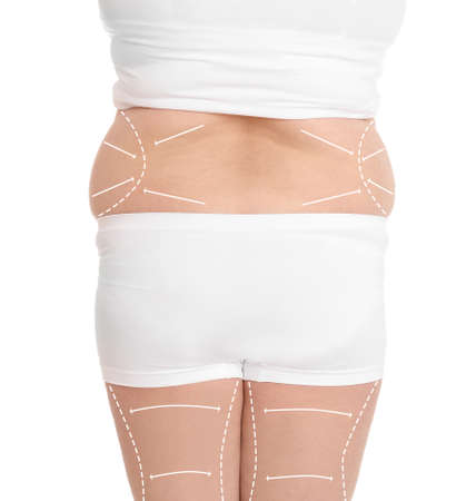 Woman in underwear on white background, closeup. Weight loss concept
