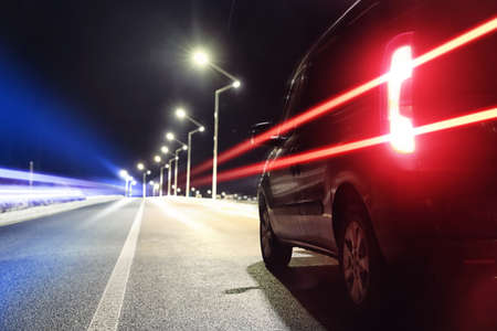 Modern car on asphalt road at night. Design with light effects 스톡 콘텐츠 - 124656913