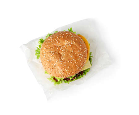 Parchment with tasty fresh burger isolated on white, top view