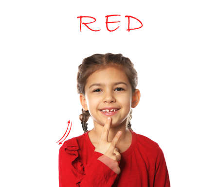 Little girl showing word RED on white background. Sign language