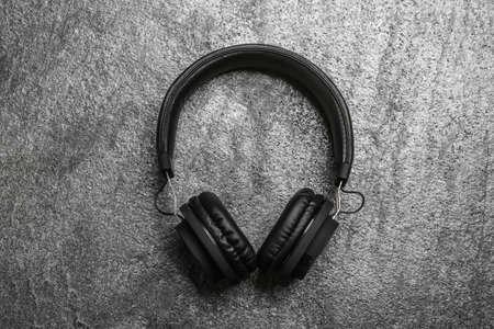 Stylish headphones on grey background, top view