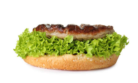 Burger bun with lettuce and cutlet isolated on white
