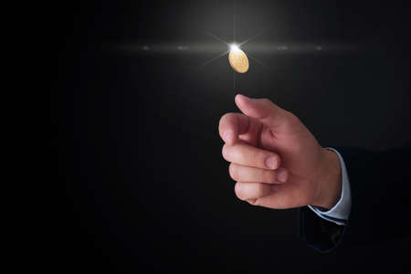Businessman throwing coin on black background, closeup. Space for text Banque d'images - 124666914