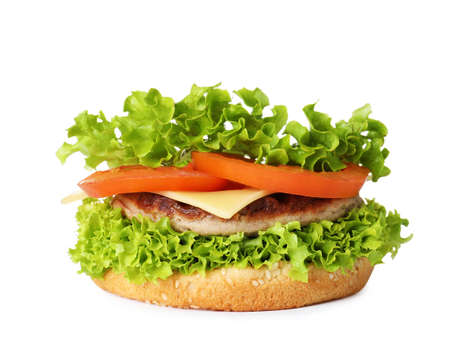 Burger bun with cutlet and vegetables isolated on white Stock Photo