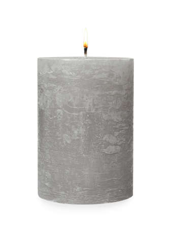 One alight wax candle on white background