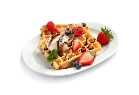 Plate with yummy waffles, berries and ice cream on white background Imagens