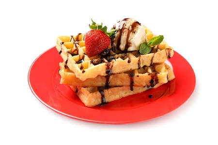 Plate with yummy waffles and ice cream on white background Imagens
