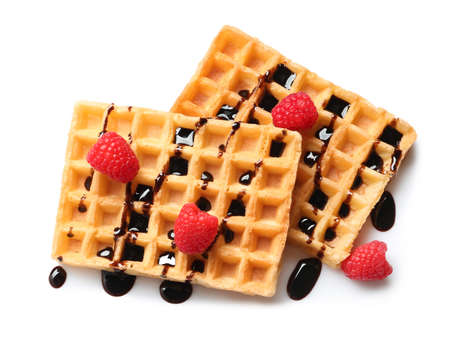 Delicious waffles with raspberries and chocolate syrup on white background, top view Imagens