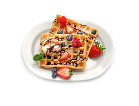 Plate with yummy waffles, berries and ice cream on white background, top view Imagens