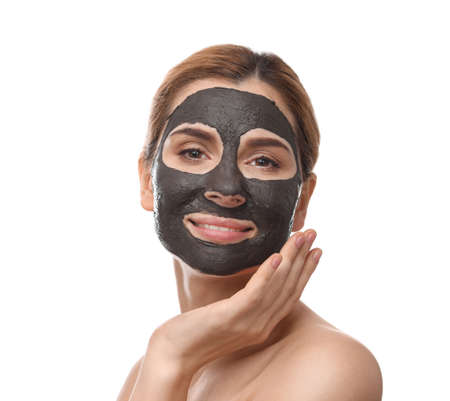 Beautiful woman with black mask on face against white background